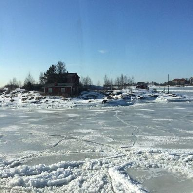 House on what would ordinarily have been an island, now icebound.