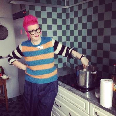 Rachael House making porridge for 20