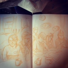 Sketch of everyone around the table, all drawing or thinking